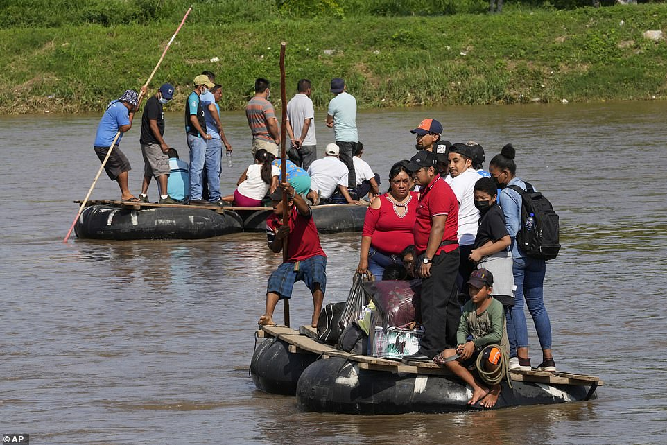 Harris' first foreign trip comes as migrants continue to make the trek from Central America to the U.S. southern border. Here people ride rafts across the Suchiate River between Ciudad Hidalgo, Mexico and Tecun Uman, Guatemala on June 7, 2021