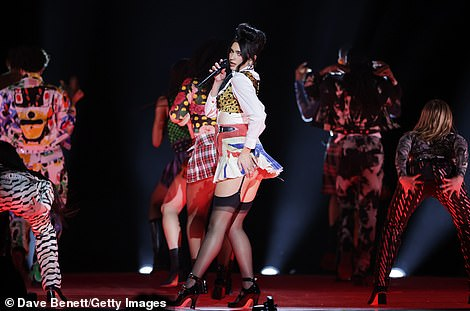 Failure to give the green light to capacity crowds could prove a hammer blow to the music festival sector, which is worth £1.1billion. Pictured: Dua Lipa performs at the 2021 BRIT Awards