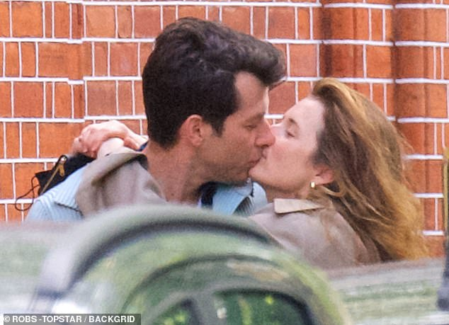 Loved-up: Mark and Grace are thought to have been dating since last year and have both been married before (pictured in London at the end of May)