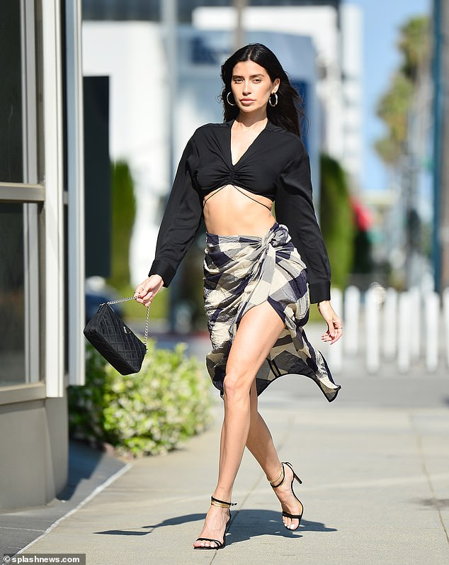 Strut: WAGS alum Nicole Williams English looked leggy while modeling for a FWRD shoot in Beverly Hills on Sunday