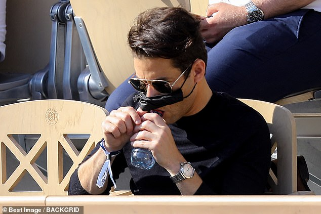 Refreshed:The Bohemian Rhapsody star, 40, looked stylish in a black top and matching face mask at Roland Garros, while soaking up the sun