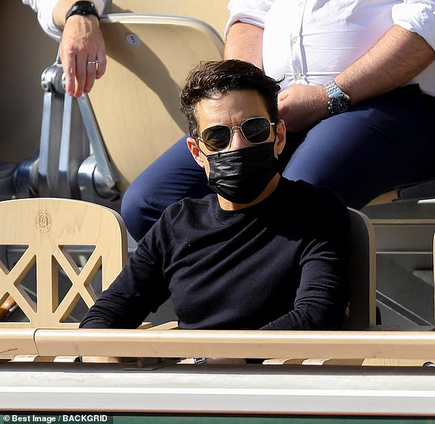 Here he is:Rami Malek cut a casual figure in all-black as he took in the action-packed women's singles quarter-final match at the French Open in Paris on Tuesday