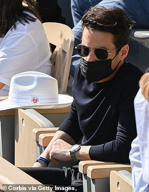 Focus: Rami looked typically handsome as he watched the quarter-final