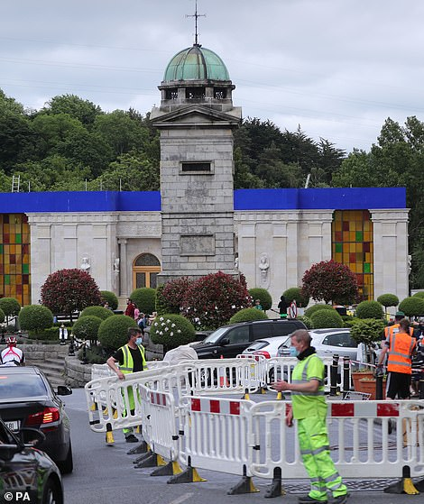 Hard at it: Work was underway to transform part of the village of Enniskerry into a Disney film set