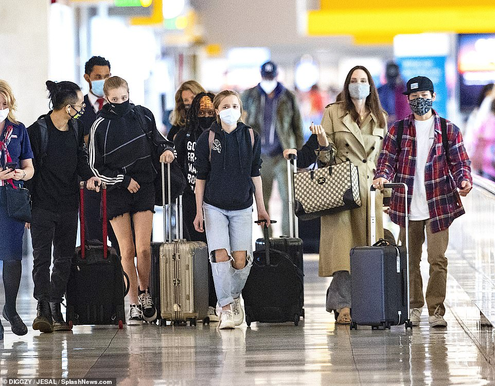 Angelina's brood on the move! Jolie was pictured on Saturday landing in New York's JFK airport with all six of her children, (L-R, Maddox, 19,Shiloh, 14,Zahara, 16,Vivienne, 12, andPax, 17, whileKnox, 12, was also there.)