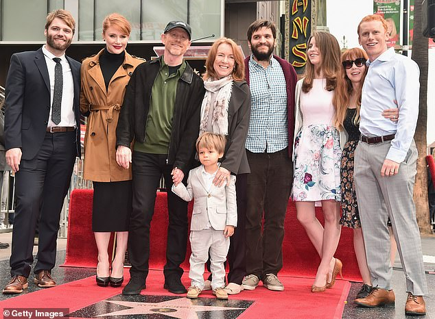 A big family: The couple with their daughter Bryce Dallas Howard and her husband Seth Gabel, far left, and Reed Cross Howard (R) on the Hollywood Walk of Fame in 2015