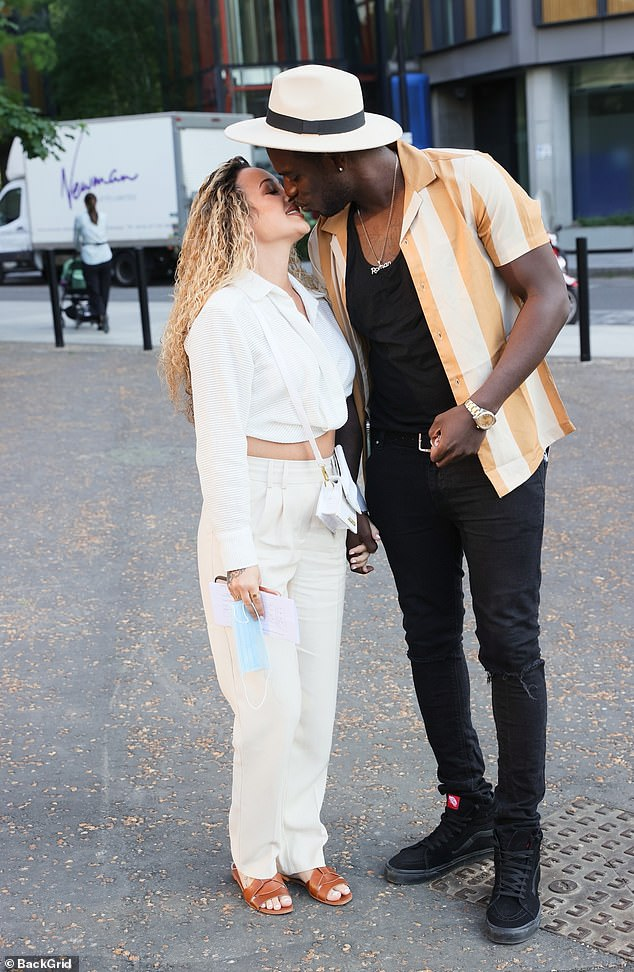 Loved up: The former Love Island star, 35, and his love, 25, cosied up to one another and shared a sweet kiss as they arrived at the star-studded event