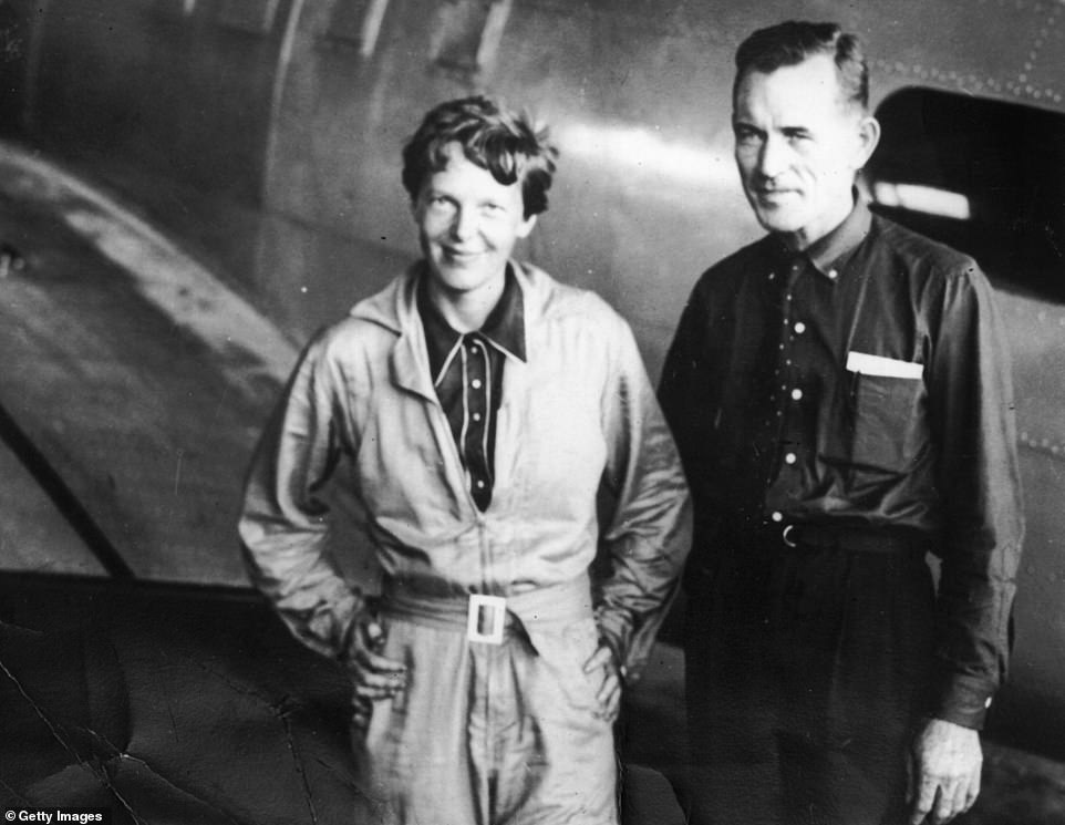 Pictured are Amelia Earhart (left) and Captain Fred Noonan (right) on June 11 1937. This was 10 days into their adventure when the pair stopped at the hangar at Parnamerim airfield, Natal, Brazil,