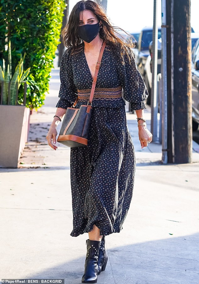 Looking fab:Courteney Cox was stylish as ever when she was spotted stepping out for dinner in Santa Monica this week
