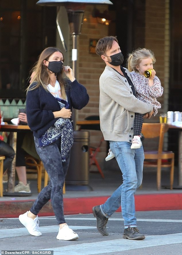 Family affair: Breaking Bad star Aaron Paul, 41, carried daughter Story, 3, in his arms as he left Little Dom's restaurant in Los Angles with wife Lauren Parsekian on Tuesday
