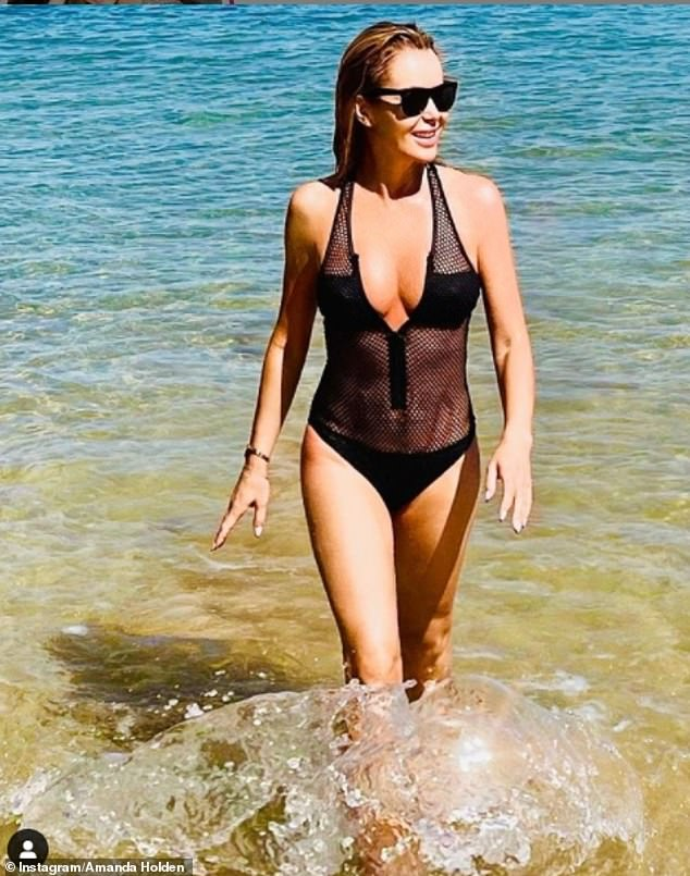 Insane: Last week, Amanda looked incredible in a plunging mesh swimsuit as she enjoyed a trip to Portugal