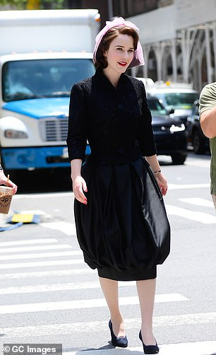 Stunning:Rachel Brosnahan got into character as Miriam 'Midge' Maisel on the set of The Marvelous Mrs. Maisel season four in New York on Tuesday where she wore a stylish black dress