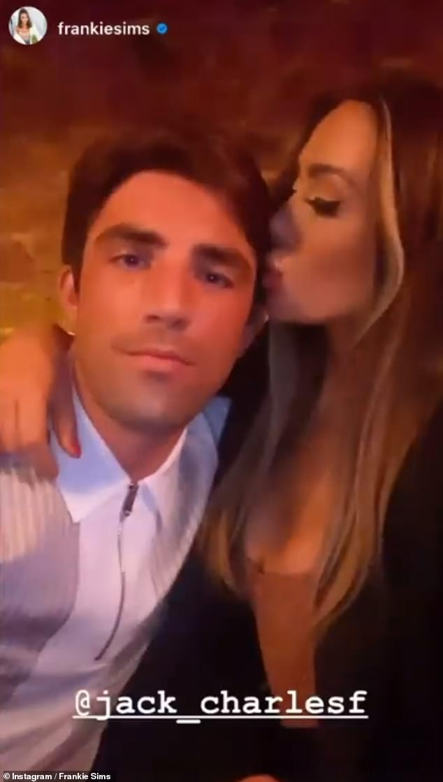 Sweet:The TOWIE star, 26, placed several kisses on Jack's head as they packed on the PDA inside the bar