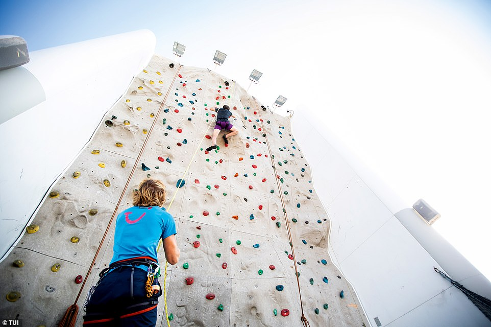 High life: Rock walls rise up above the decks of big Tui ships where you can learn how to climb with the help of gym staff