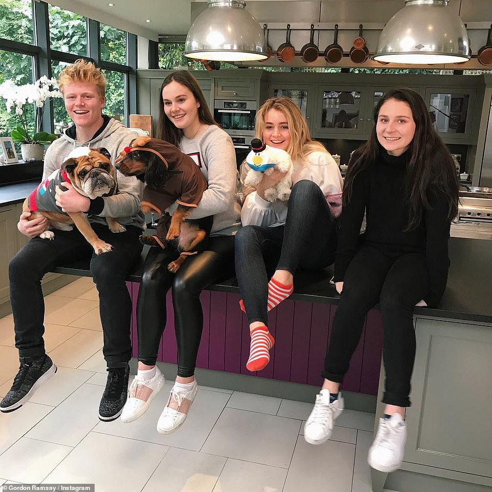 Impressive:According to The Sun , the TV personality now wants to renovate his London mansion and has 'submitted plans to his local council', which will add 76m2 to the property (four of his five children pictured in kitchen)