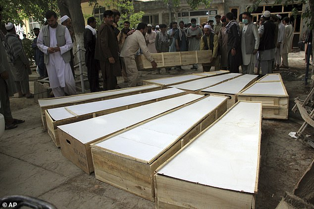 Masked insurgents have shot dead 10 Afghans working for a mine-clearing charity the Halo Trust - championed by Prince Harry and his mother Princess Diana. Pictured:The coffins of the victims in Tuesday's attack are placed on the ground at a hospital in northern Baghlan province, Afghanistan, Wednesday, June 9, 2021