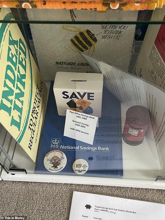 Assorted memorabilia from what is now National Savings & Investments, including an advert for inflation-linked savings certificates, which still exist but are no longer on-sale