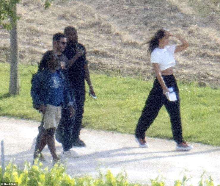 Sight-seeing: Irina is pictured looking ahead while on her walk with Kanye, following heated rumours the pair are now an item