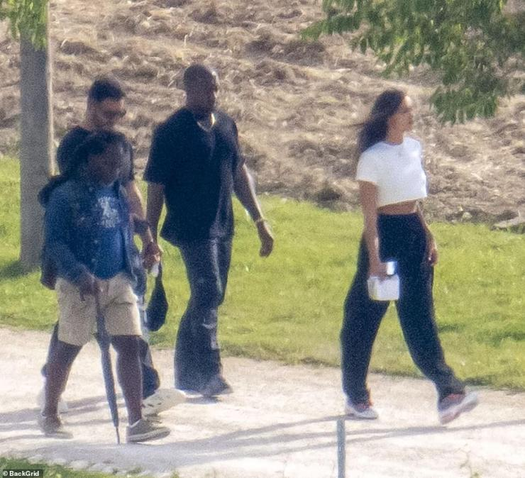 Enjoying the view: Kanye was seen walking behind Irina as he was also joined by members of his team