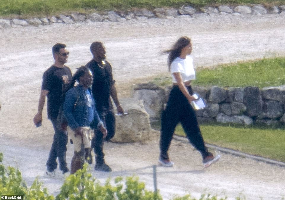 A walk to remember: The 44-year-old rapper certainly appeared to be in a happy mood as he stepped out with Irina