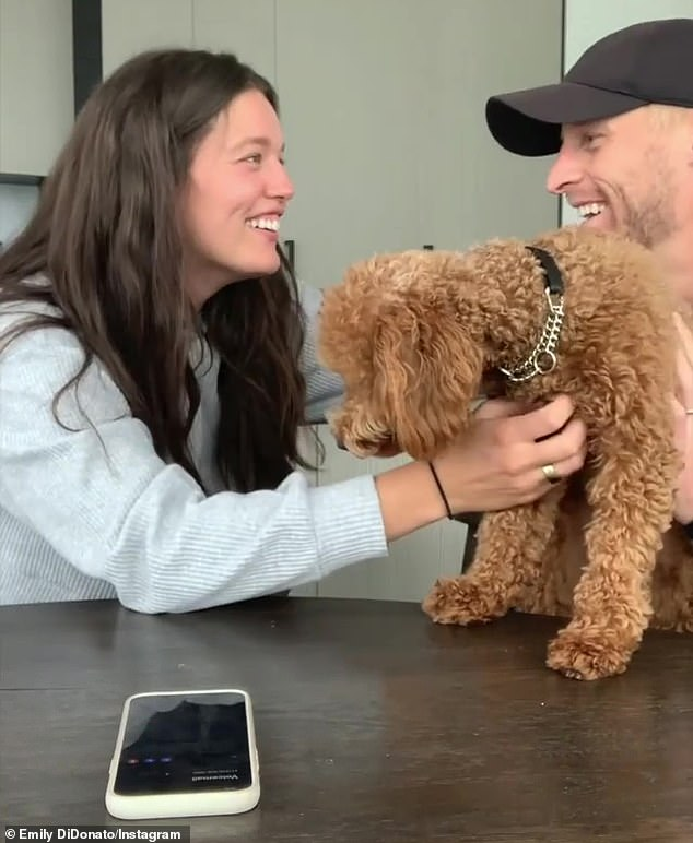 Cute:Near the end of the video, Emily and Kyle are seen sitting at a table with their dog, Izzy as they wait to find out the gender of their baby. After her doctor told the couple that they are having a girl, Kyle hugged his wife and said, 'Three girls in my life'