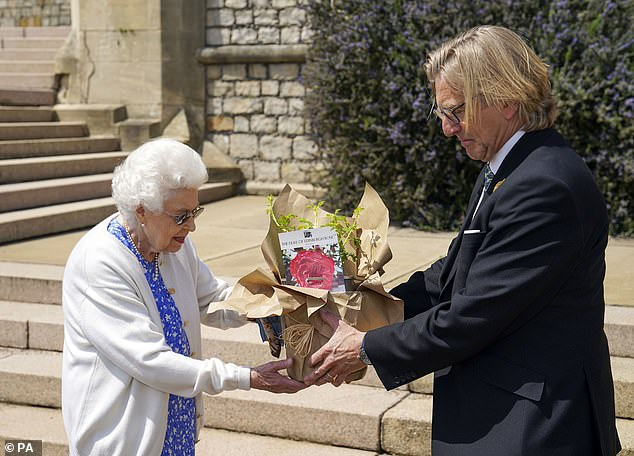The rose (pictured being gifted to the Queen) was later planted in a mixed rose border at Windsor Castle