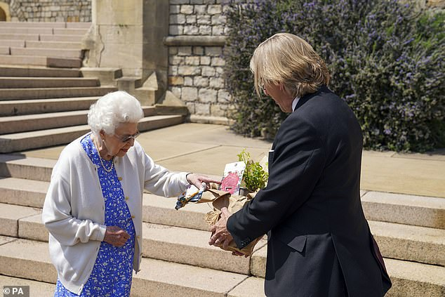 The Queen receives a Duke of Edinburgh rose, given to her by Keith Weed, President of the Royal Horticultural Society