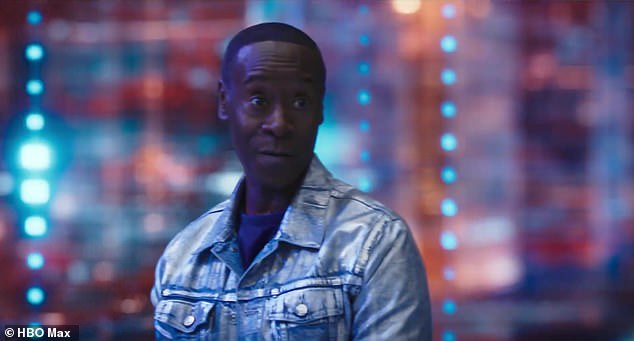 Driving force: The athlete then speaks with the evil computer program, played by Don Cheadle, who tells him that he must play a game of basketball in order to save his son