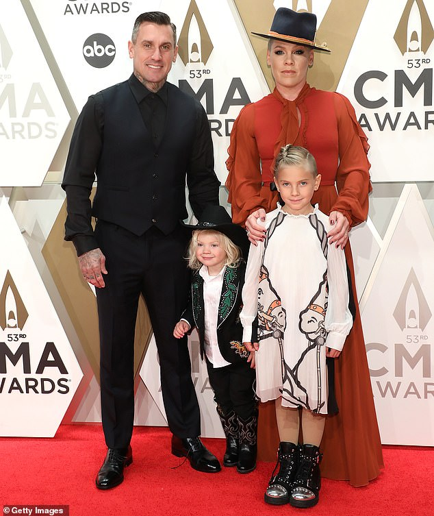 Growing stronger: Hart and Pink separated in 2008, although they reconciled and welcomed their two children after undergoing marriage counseling; they are seen with their kids at the53rd CMA Awards in 2019