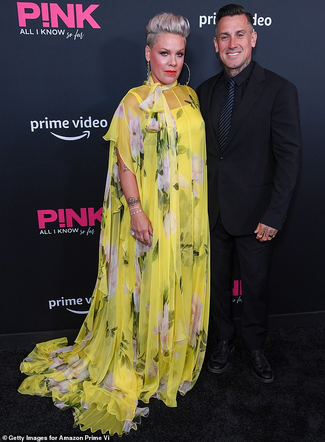 Happy couple: The Raise Your Glass singer and the former professional motocross racer met just under two decades ago and have been married since 2006; they are seen together in May