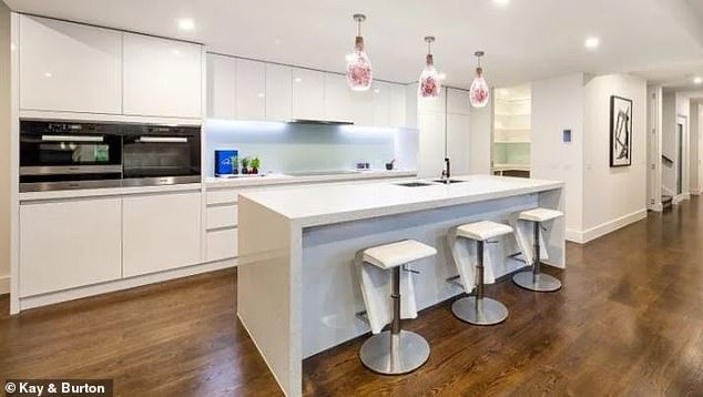 Modern:The property also has a stone and Miele kitchen, and a north-facing outdoor terrace with a barbecue kitchen