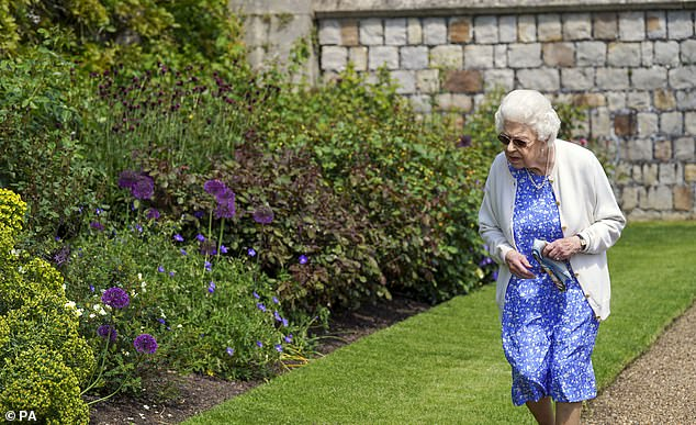 Philip, an inspirational and committed champion of young people, established the awards 65 years ago. Pictured, the Queen walking around the Windsor Castle grounds