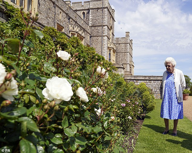 The Duke of Edinburgh's Award scheme became one of Philip's most remarkable achievements. Pictured, the Queen in her garden