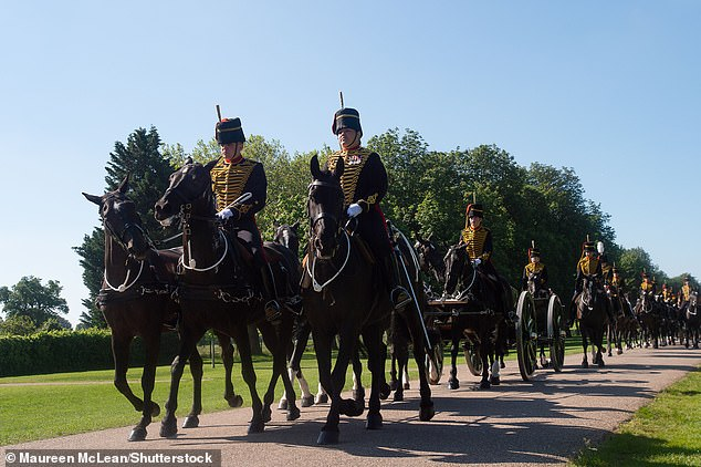 The Kings's Troop Royal Horse Artillery and the Household Cavalry Mounted Regiment ride along the Long Walk today