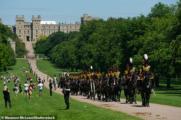 The event has been scaled back due to the pandemic and will be held at Windsor castle on Saturday. Usually, the occasion is held at Buckingham Palace. Pictured, the rehearsals