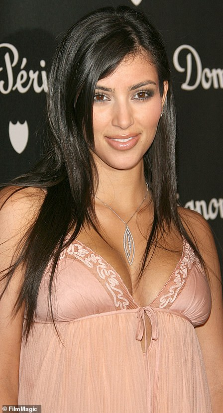 Boosted bust: Kim, pictured left in 2006, has also spent more than a decade denying claims that she has had a breast augmentation