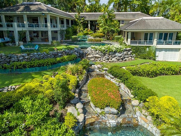 Gorgeous: The sprawling property, which boasts 360 degree ocean views, boasts five bedrooms, six bathrooms, a two-car garage, and a resort-style pool