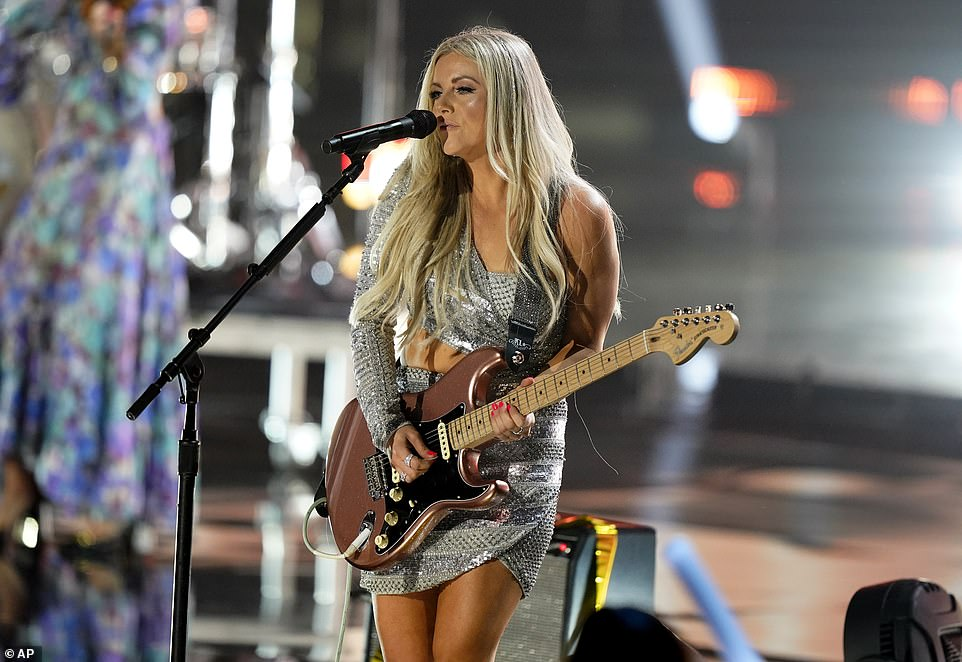 Rocking out: Lindsey Ell shredded on the guitar after filling in for Gabby Barrett