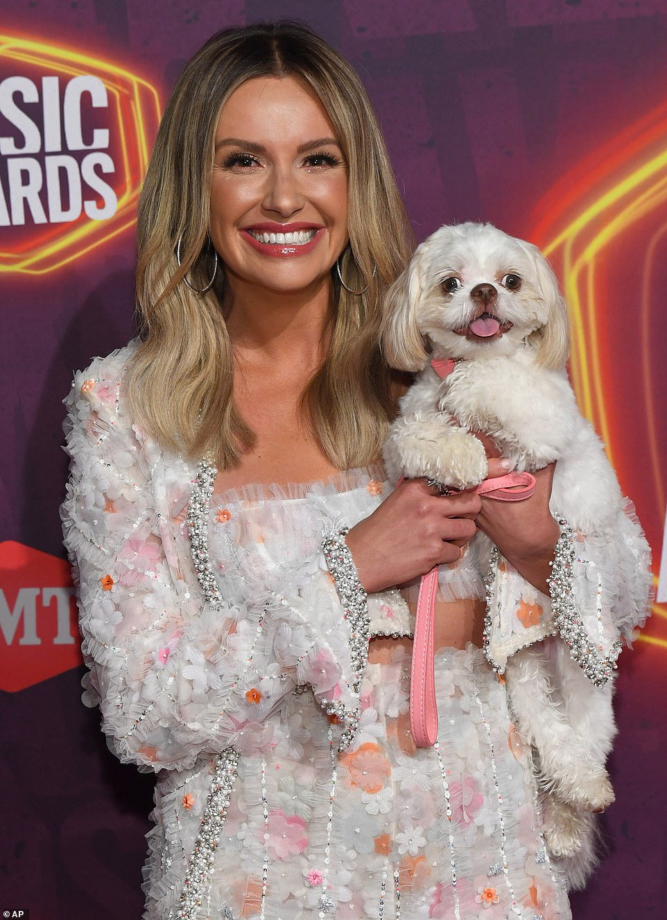 Furry friend:Carly Pearce had some furry support on Wednesday night as she arrived to the ceremony with her beloved pooch June