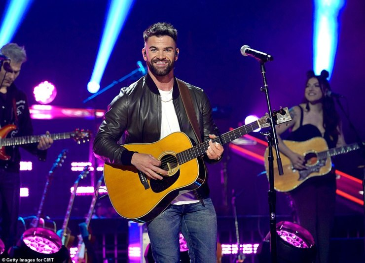 Turning it up:Dylan Scott followed her by singing his track Nobody