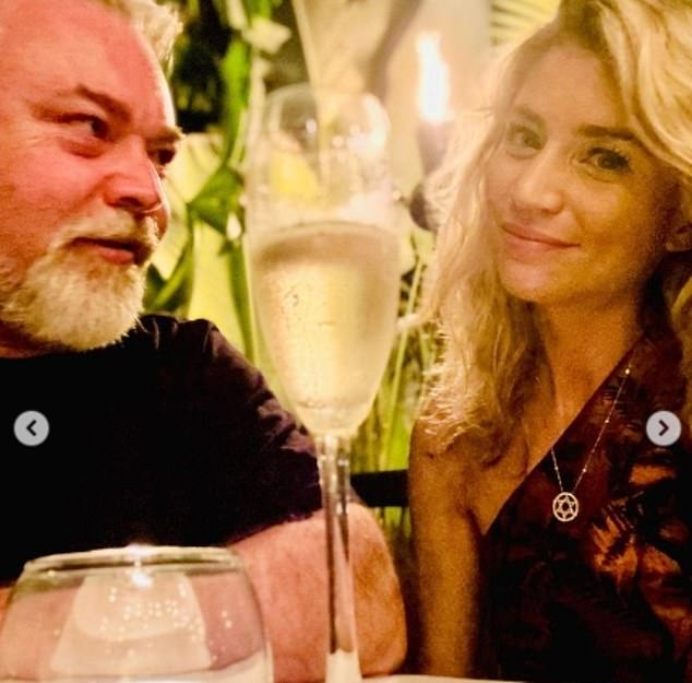 He's smitten:In another, Kyle is seen gazing affectionately at his girl at dinner