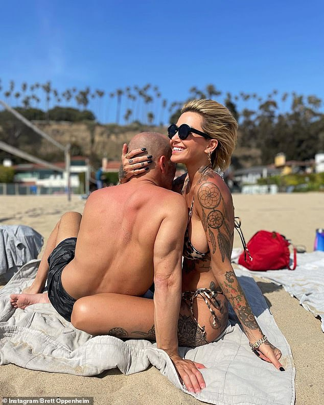 Still on?after being linked to Brian Austin Green and P. Diddy, tattooed model Tina Louise has now hinted her latest romance with Selling Sunset's Brett Oppenheim may be on the rocks