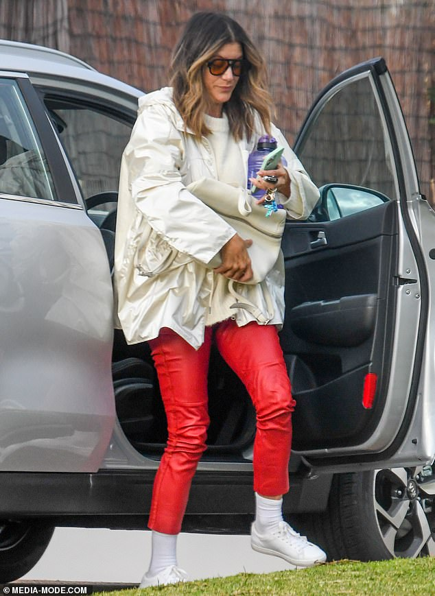 Home: Grey's Anatomy star Kate Walsh, 53, (pictured) arrived back to flowers at her Perth home on Wednesday as the Hollywood star prepares to fly back to the United States