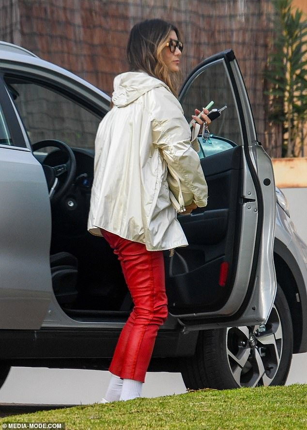 On the go:The active actress carried her phone along with a water bottle as she left the car