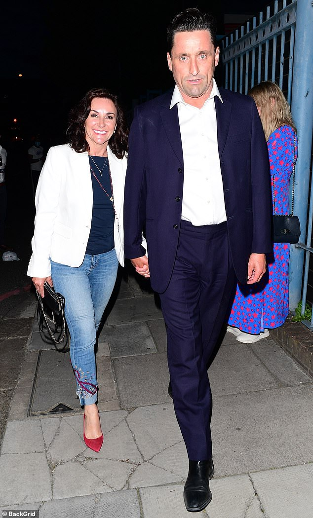 PDA:The Strictly judge, 60, and actor, 48, packed on the PDA as they walked hand-in-hand to the venue together
