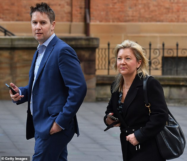 Nine executive editor of Australian metro publishing James Chessell (left) and editor of The Sydney Morning Herald, Lisa Davies (right) arrive at the court on Monday