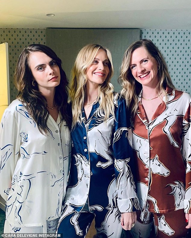 Terrific trio: Sisters Cara, Poppy and Chloe Delevingne slipped into matching pyjamas for a slumber party on Wednesday