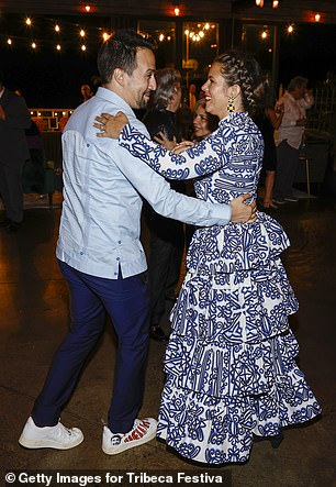 Likes him: Lin couldn't stop smiling as he wrapped his arm around his wife and danced
