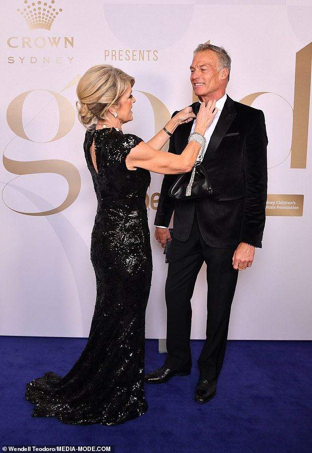 Glamorous:The 64-year-old oozed sophistication in a sparkly long black gown that clung to her trim figure as sheattended the event with her boyfriend David Panton