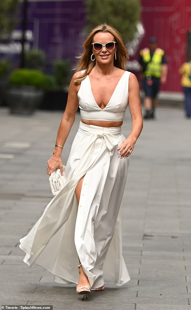 Wow:Amanda Holden, 50, ensured all eyes would be firmly on her as she put on a busty display while leaving the Heart FM studios in London on Thursday